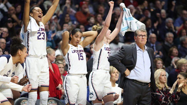 UConn women's girls basketball team cheering with Geno Auriemma