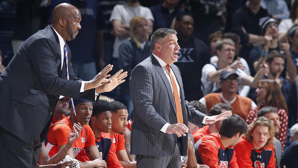 Auburn assistant coach Chuck Person coaching alongside head coach Bruce Pearl