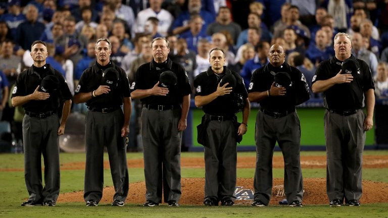 Umpires standing on a baseball field