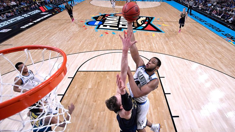 Omari Spellman shoots over Moritz Wagner in the 2018 NCAA Men's Final Four National Championship Game