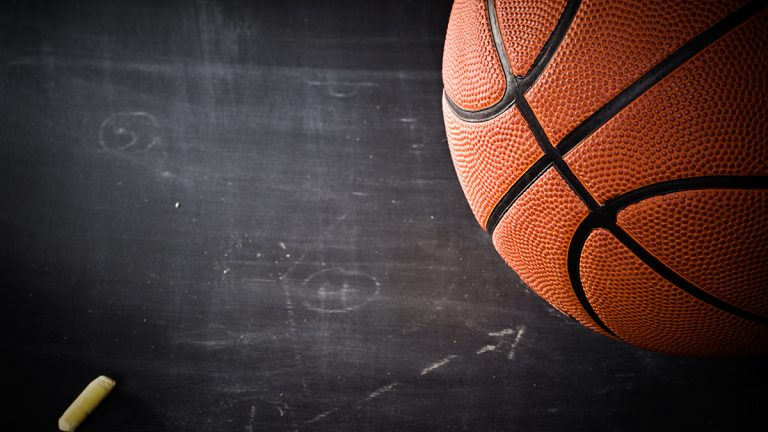 close up of basketball on chalkboard