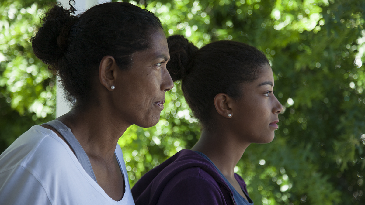 Reyana Abrahams-Ewing, a tennis prodigy in apartheid South Africa, and her daughter, Salma stare off into the distance.