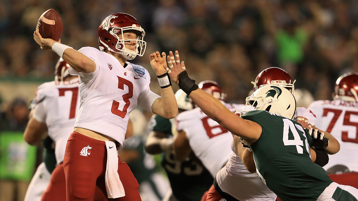 Washington State quarterback Tyler Hilinksi throws football in the Holiday Bowl against Michigan State