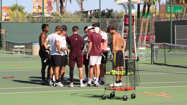 ASU men's tennis in a huddle