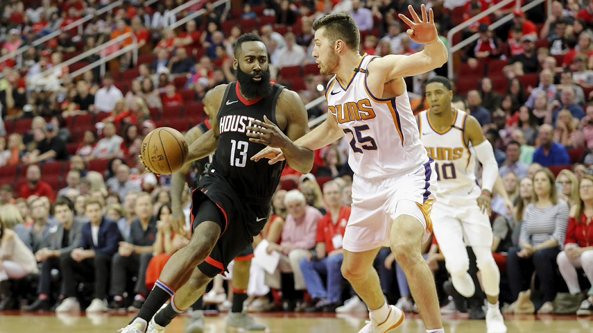 James Harden drives to the basket around Phoenix's Alec Peters