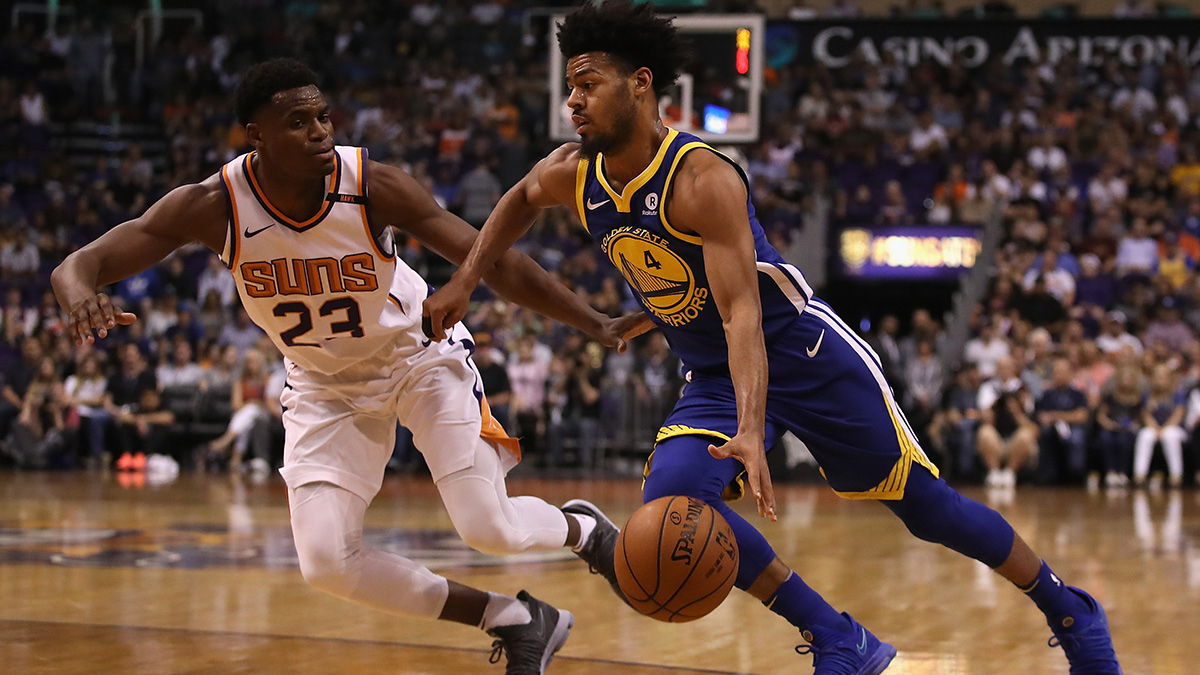 Quinn Cook of Golden State drives past Danuel House Jr. of Phoenix.