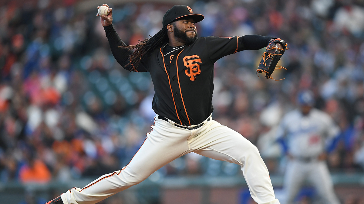 Johnny Cueto of the San Francisco Giants pitches a baseball on the mound