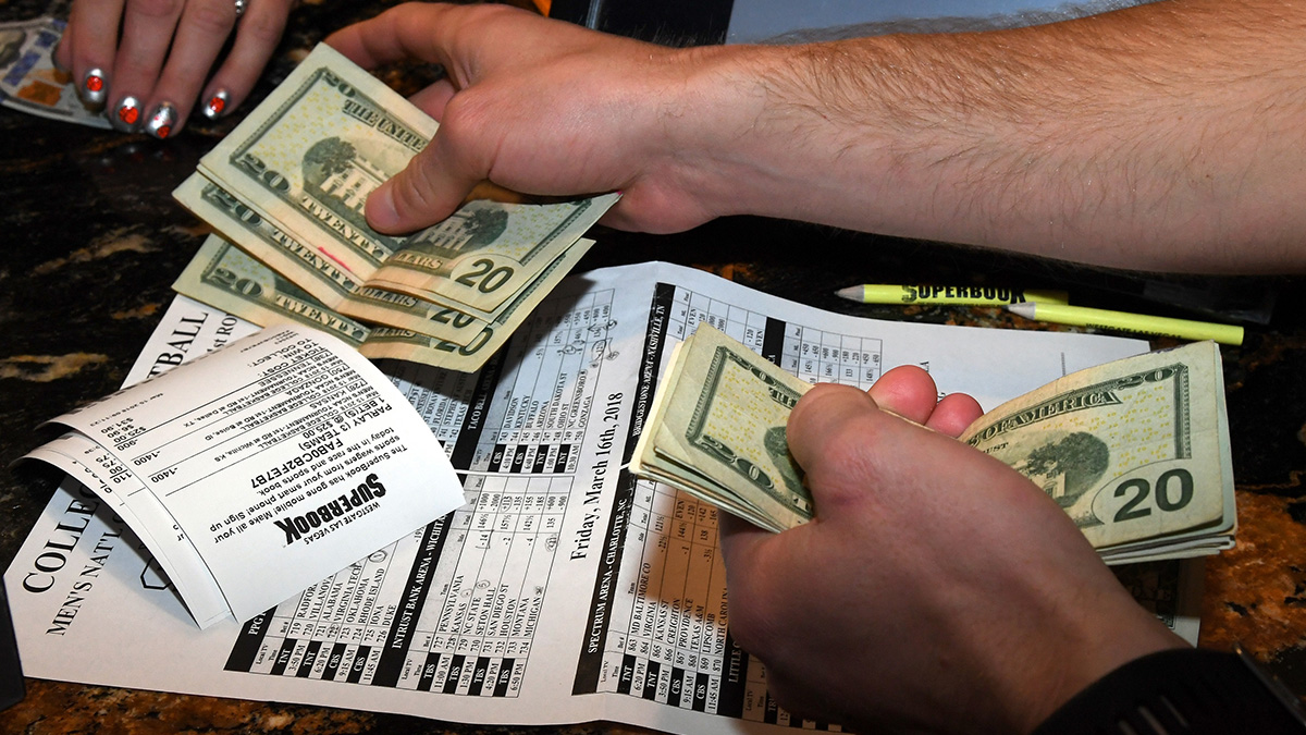 Money is handled during an NCAA tournament by a man in Las Vegas, Nevada