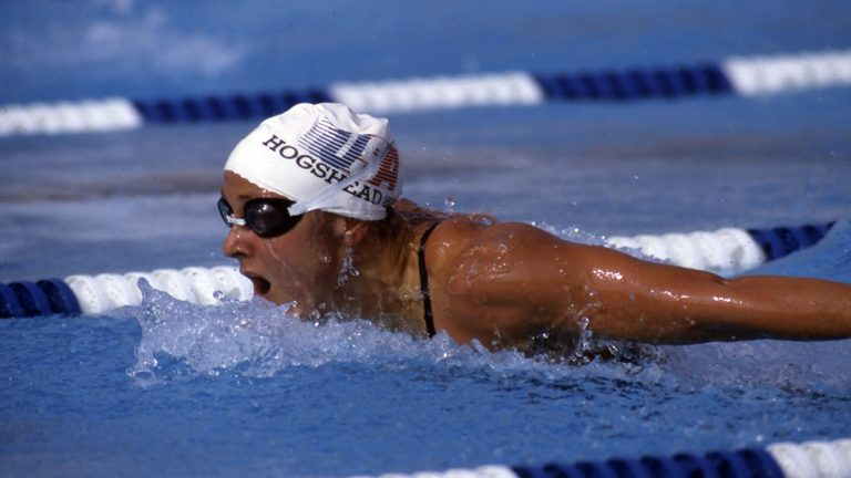 Nancy Hogshead-Makar competes in an olympic swimming event for the United States