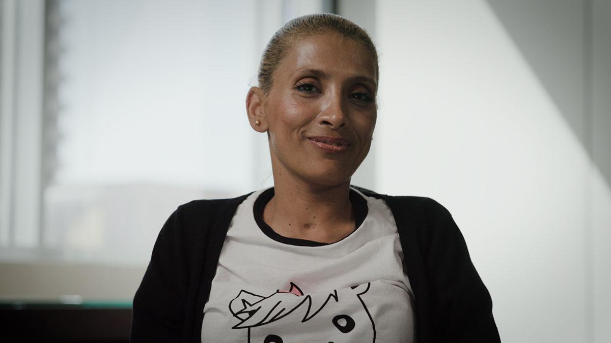 Jordanian nurse and disabilities advocate Rola Allahaweh smiling at the camera.