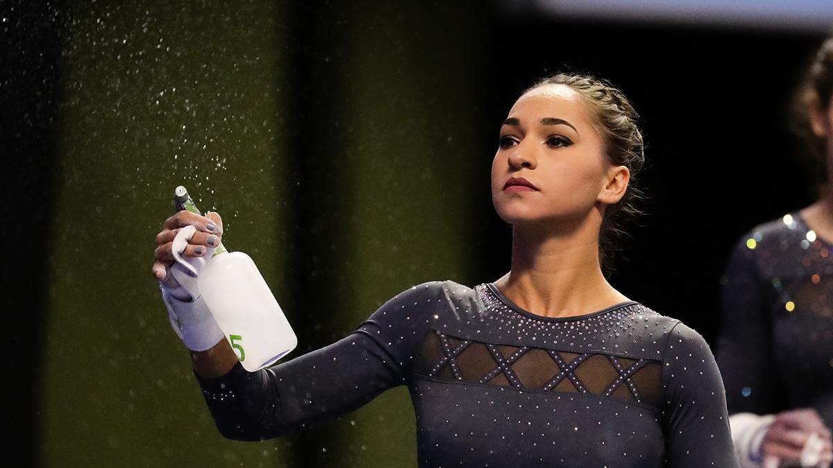 Gymnast spraying water