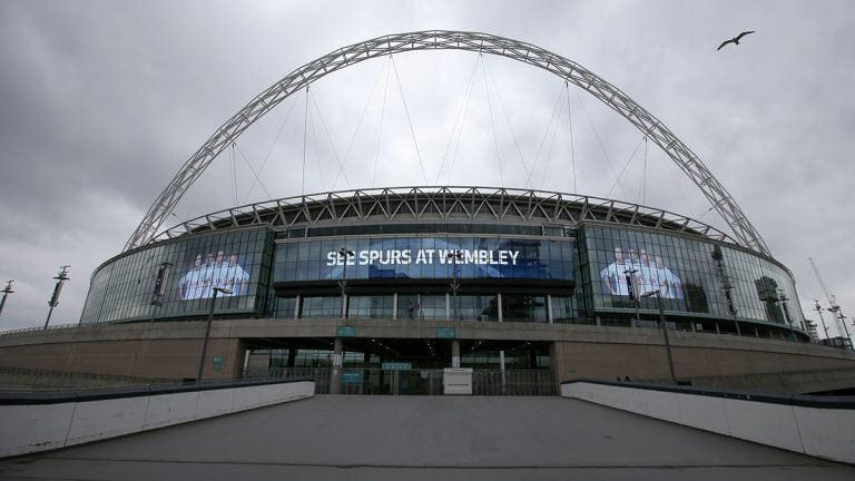 Wembley Stadium in London advertises a Tottenham Hotspurs football match