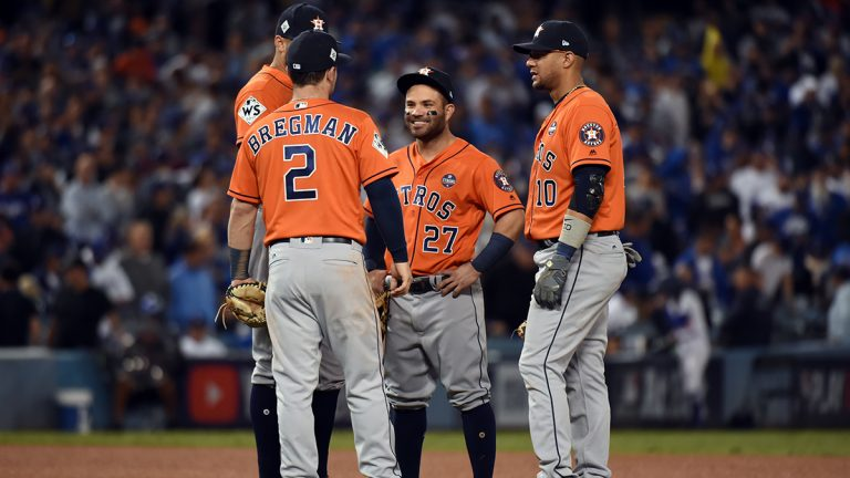 Jose Altuve, Yuli Gurriel, Alex Bregman, and Carlos Correa of the Houston Astros gather during a World Series game against the Los Angeles Dodgers