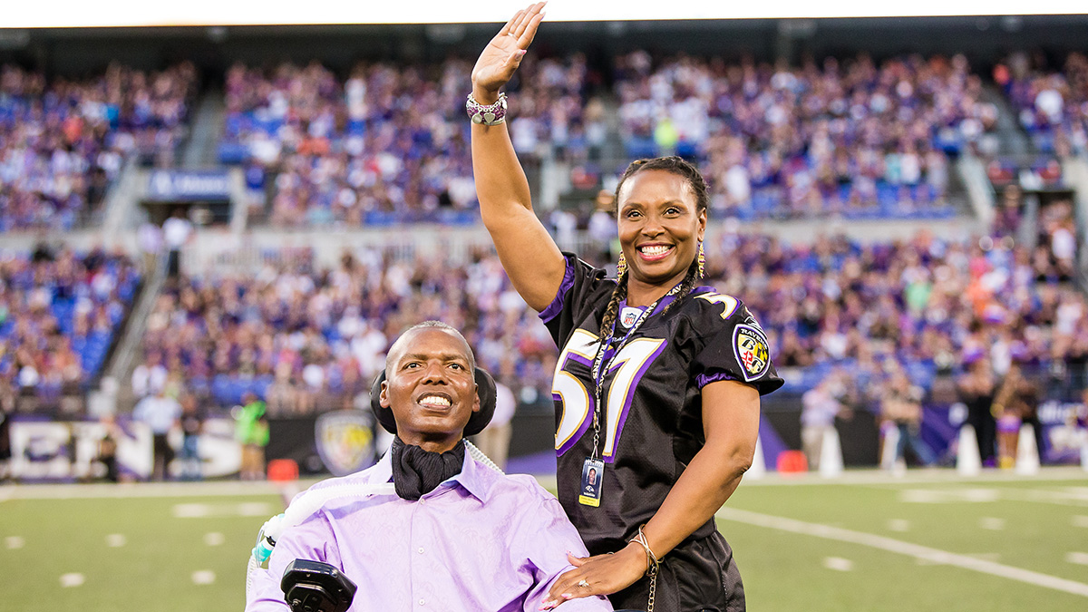 Former NFL player O.J. Brigance and wife Chanda wave to fans at Baltimore Raven's M&T Bank Stadium