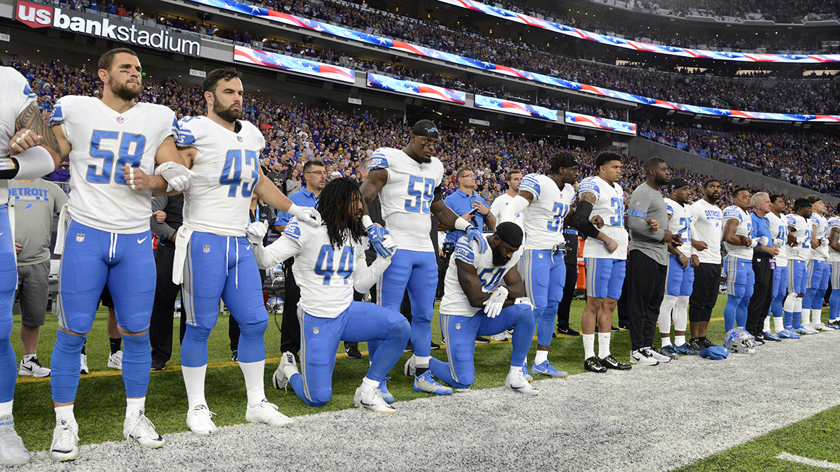 Jalen Reeves-Maybin and Steve Longa of the Detroit Lions of the NFL kneel during the national anthem to protest