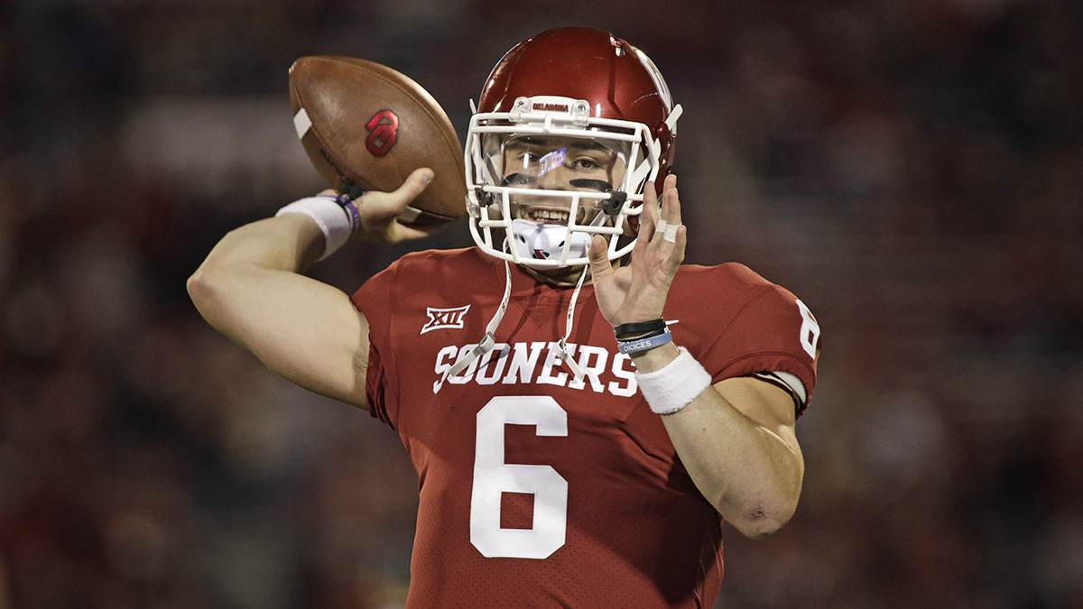 Oklahoma quarterback Baker Mayfield winding up to throw the ball
