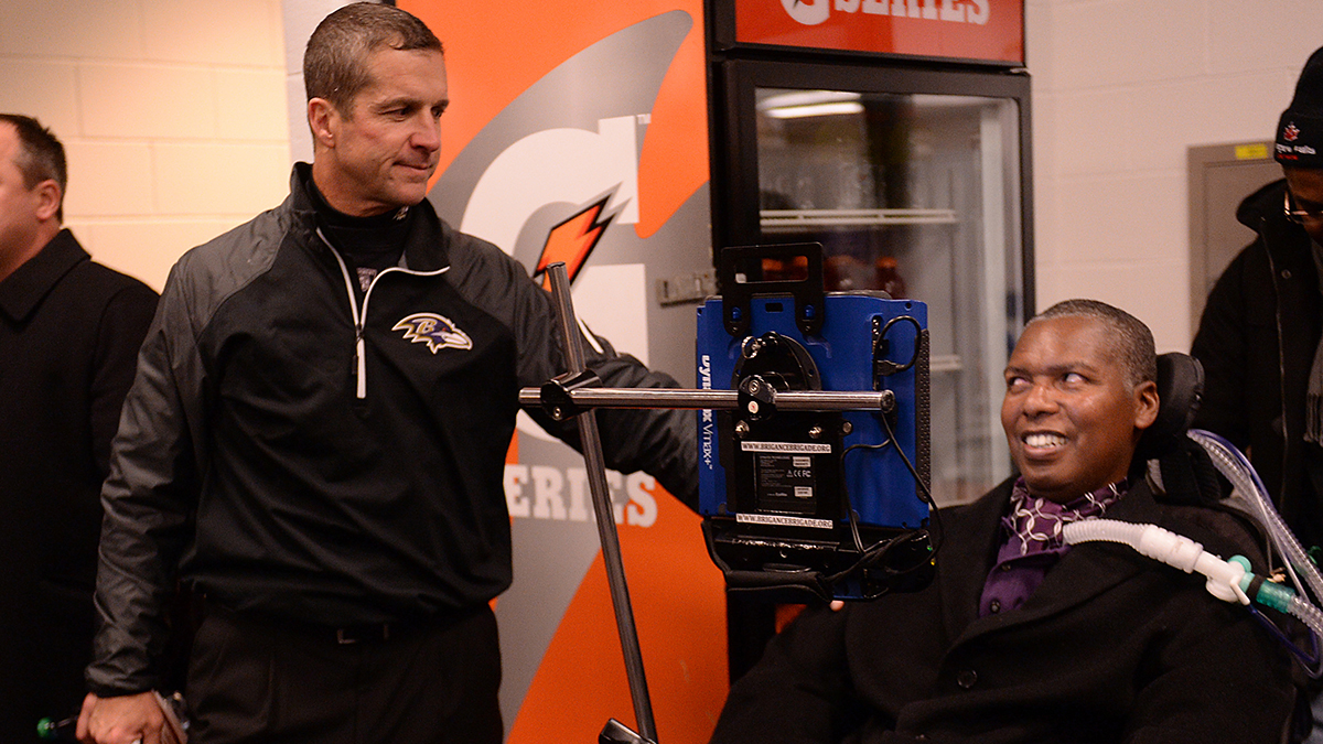 Baltimore Ravens coach John Harbaugh and former player O.J. Brigance talk before football game