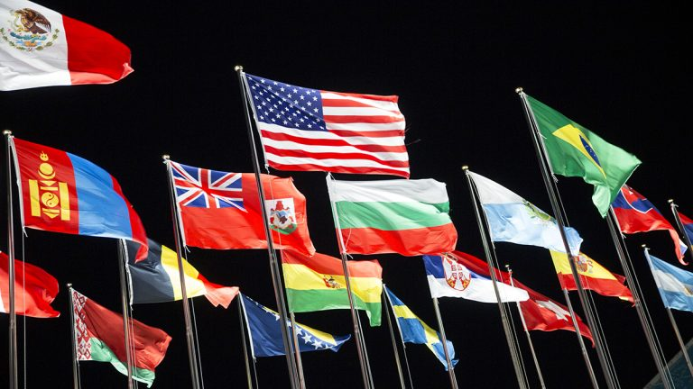 National flags from different countries waving in the wind.