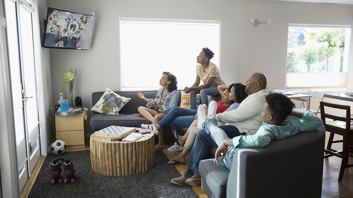 Family of six watching t.v. together