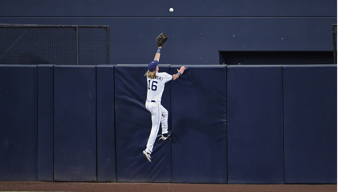 8834d972bff Travis Jankowski of the San Diego Padres climbs the wall but can t make the  catch on a home run hit by Ian Happ of the Chicago Cubs in July.