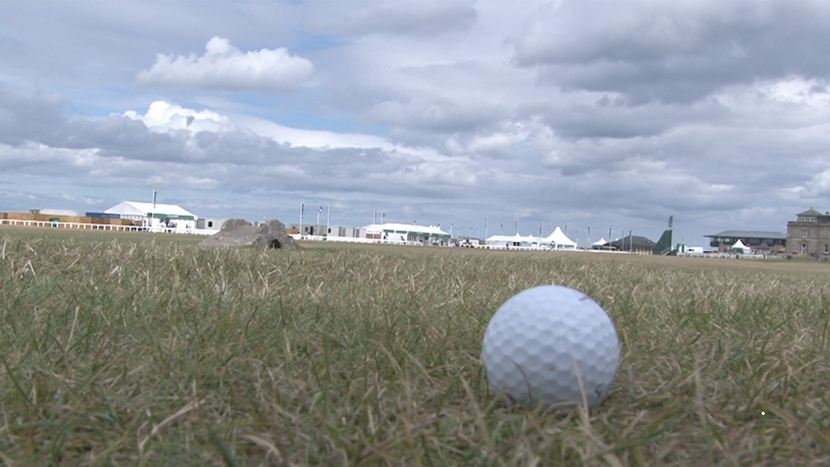 Golf ball laying in the grass at St. Andrews Links