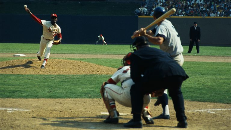 St. Louis Cardinals Bob Gibson throws the first pitch of the 1968 World Series