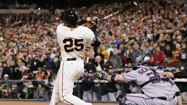 Barry Bonds swings and breaks home run record