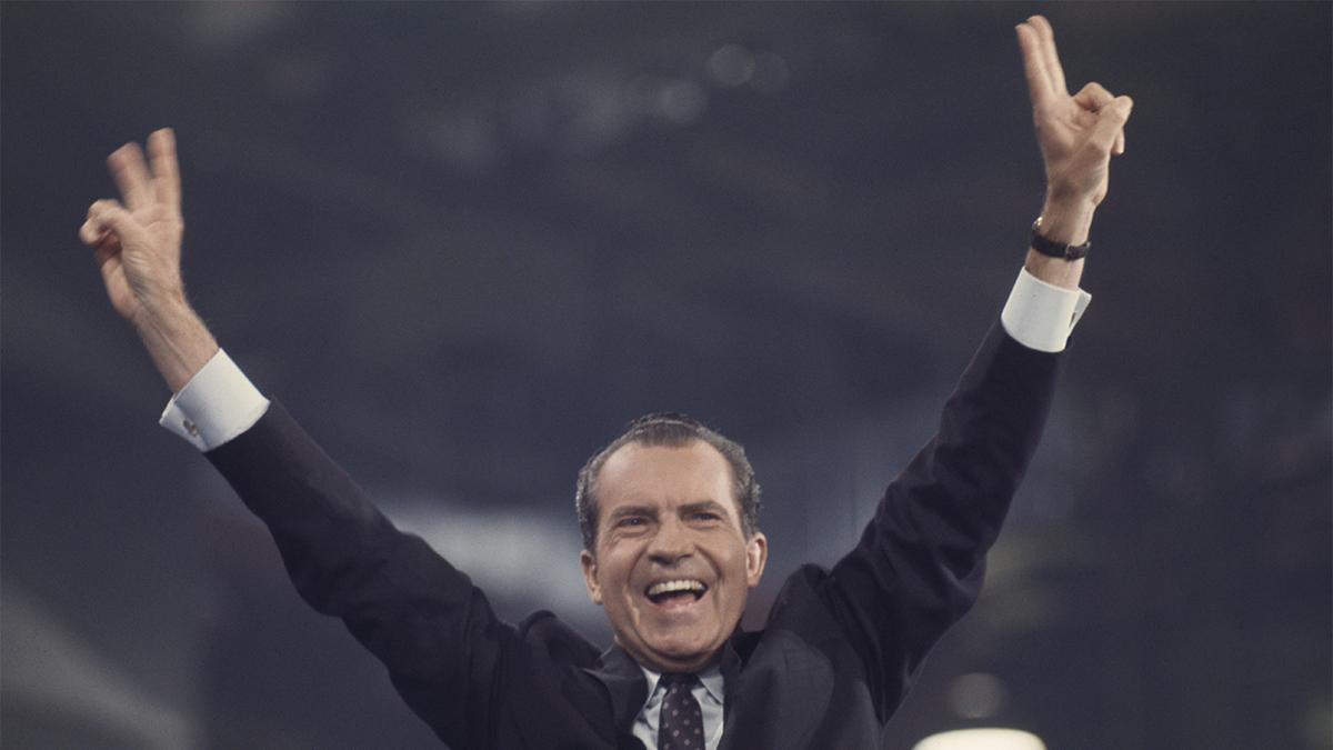 Former President Richard Nixon smiling and waving