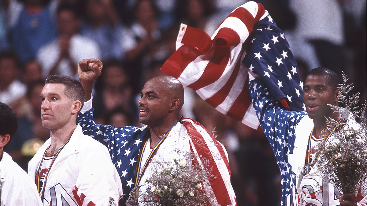 Members of the 1992 U.S. Olympic team hold up the American flag
