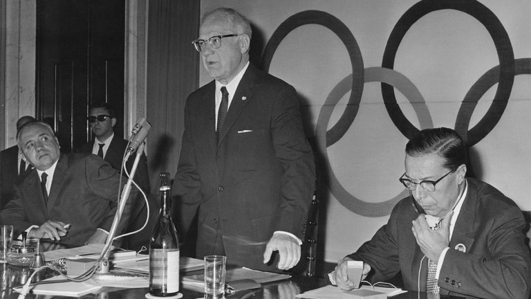 Avery Brundage stands to speak at an International Olympic Committee meeting in 1965