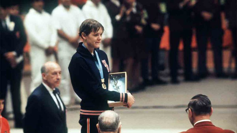 Debbie Meyer poses on the podium with her gold medal at the Mexico Olympic Games in 1968
