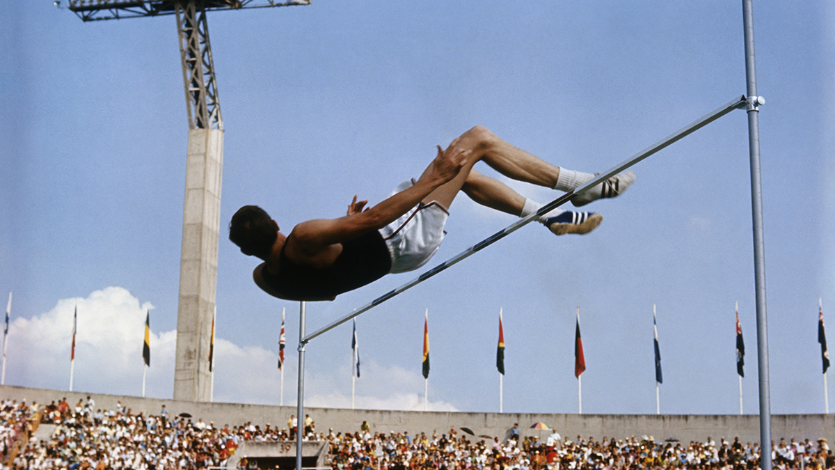 Dick Fosbury soars over the bar during the men's high jump at the 1968 Olympics in Mexico City