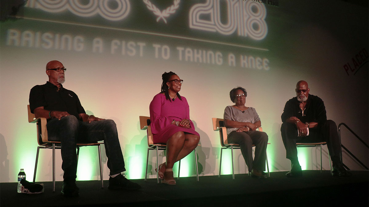 "John Carlos, Gina Hemphill-Strachan, Wyomia Tyus and Dr. Harry Edwards on stage at the ""Raising a Fist to Taking a Knee"" event in Phoenix"