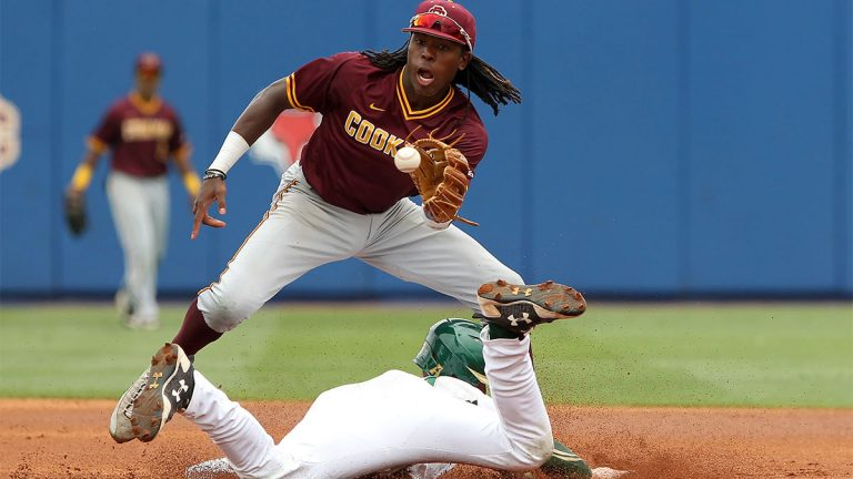 Demetrius Sims attempts to catch the ball as Duke Stunkel slides into second base