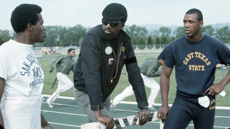 Harry Edwards talks with Tommie Smith and John Carlos
