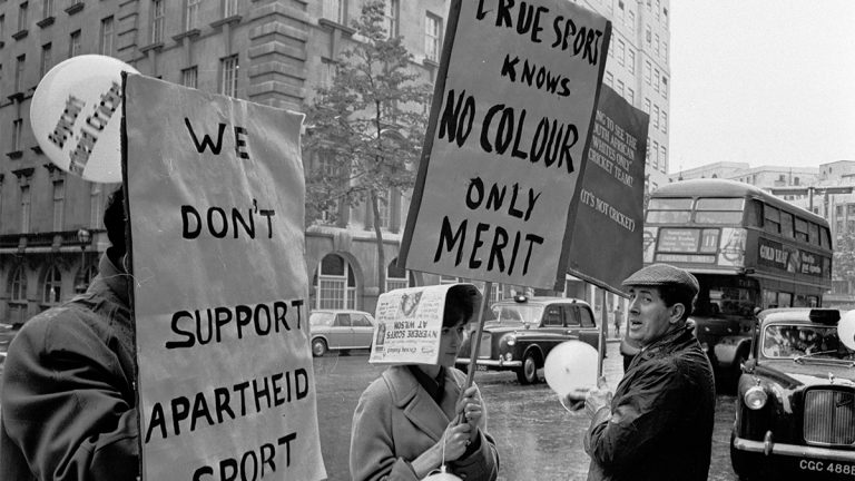 Anti-apartheid demonstrators protest outside the Waldorf Hotel in London where South African cricketers are staying in 1965