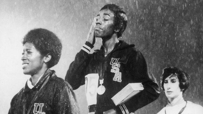 Wyomia Tyus on Olympic medal podium