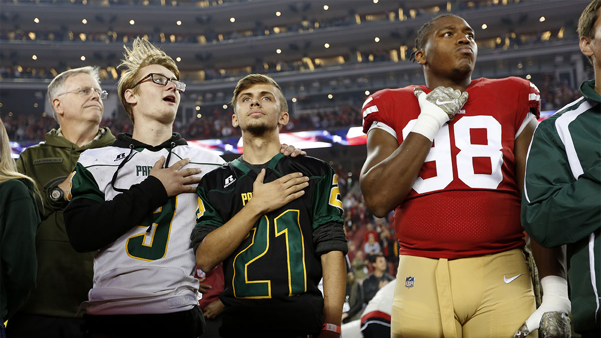 Kaleb Nelson and Austyn Swarts of the Paradise High School football team with San Francisco 49er Ronald Blair III