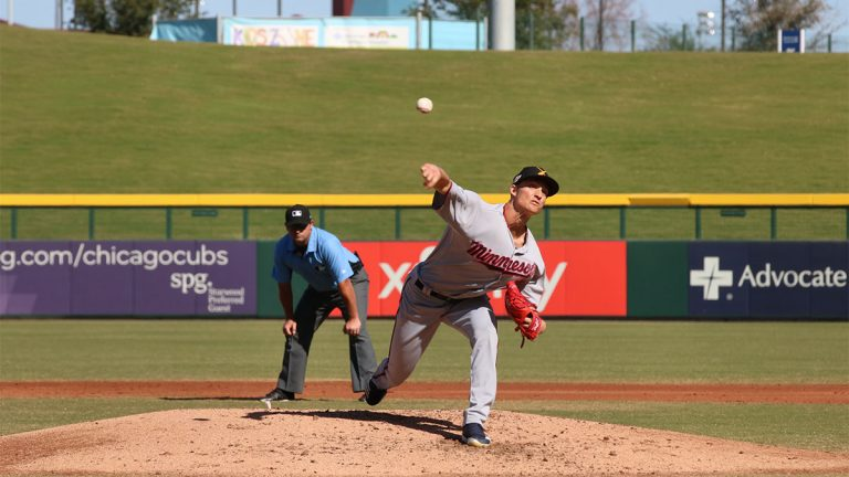 Baseball pitcher throwing a pitch during game