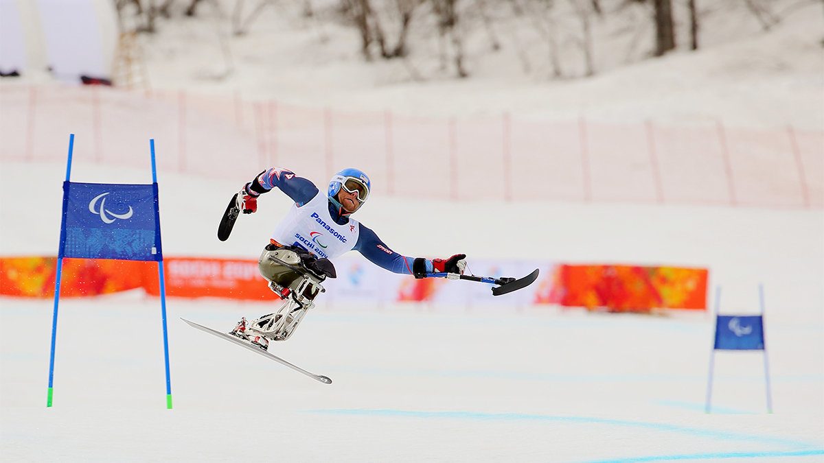Adaptive skier Tyler Walker of the United States in action as he skiis downhill on day one of the Sochi 2014 Paralympic Winter Games.