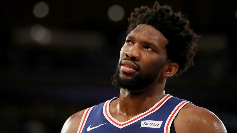 Joel Embiid, professional basketball player for the Philadelphia 76ers looks up towards his right.