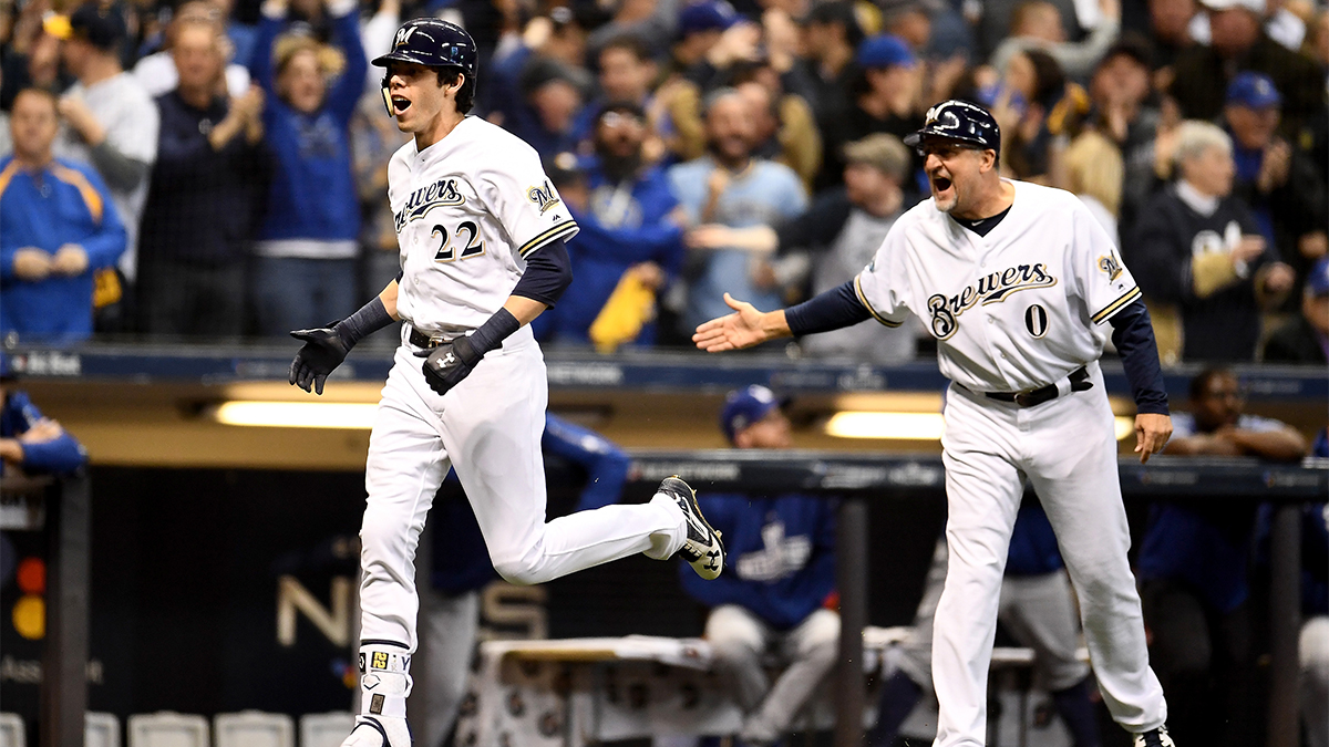 6ee0e3d3c5c Christian Yelich of the Milwaukee Brewers rounds the bases after hitting a  solo home run during the first inning in Game Six of the National League ...