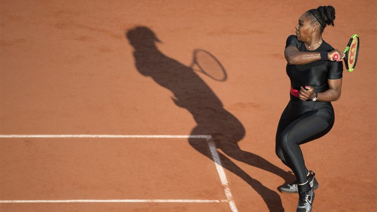 "Serena Williams in a compression ""catsuit"" at the French open playing Tennis"