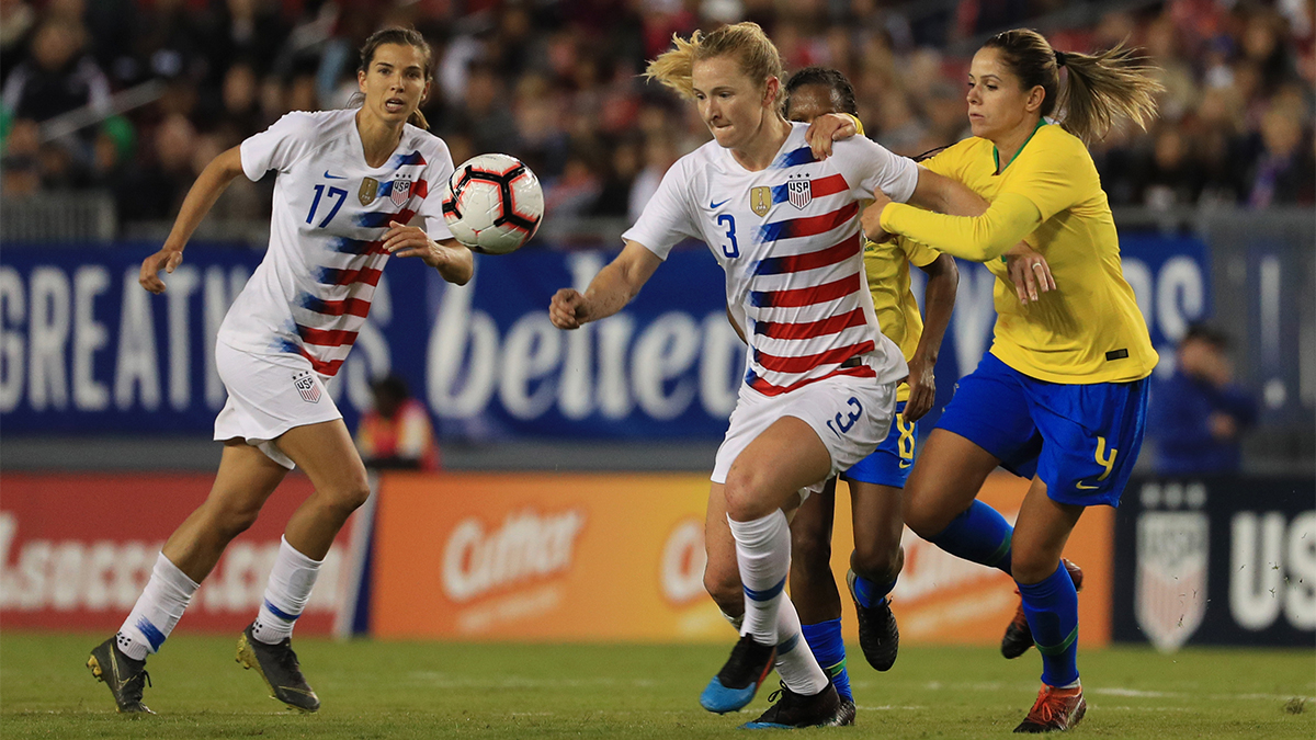 Samantha Mewis of USA soccer team looks to pass the ball over Erika of Brazil during the She Believes Cup in 2019