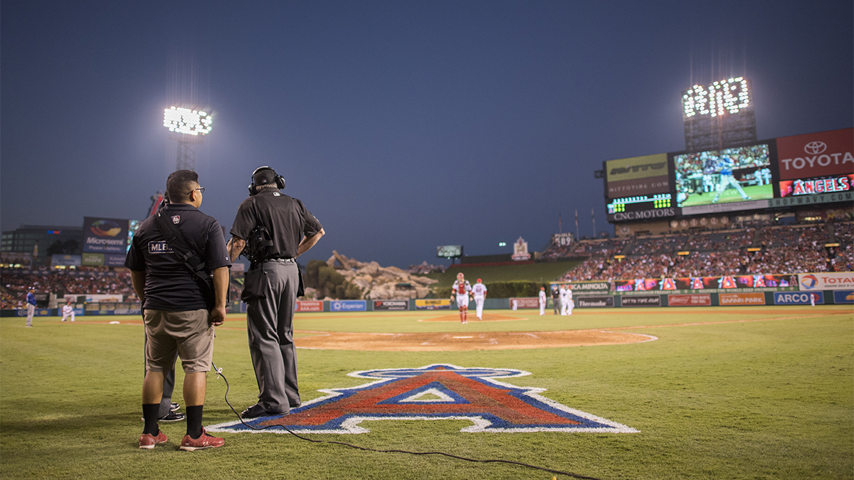 Umpire Mike Winters looks out into the field during a replay in a 2016 game between the Texas Rangers and Los Angeles Angels.