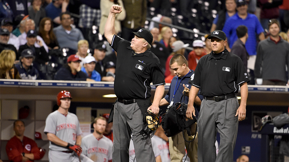 Umpire Bill Miller signals the final out in the ninth inning after an instant replay during a 2014 baseball game