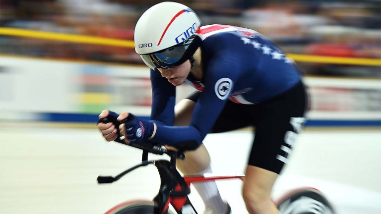 Kelly Catlin on bike with goggles and helmet