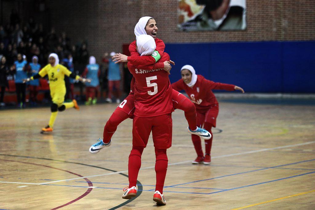 Sara Shirbeigi (No. 5) of the Iranian national futsal team celebrates with her teammates. (Photo by Maryam Majd)