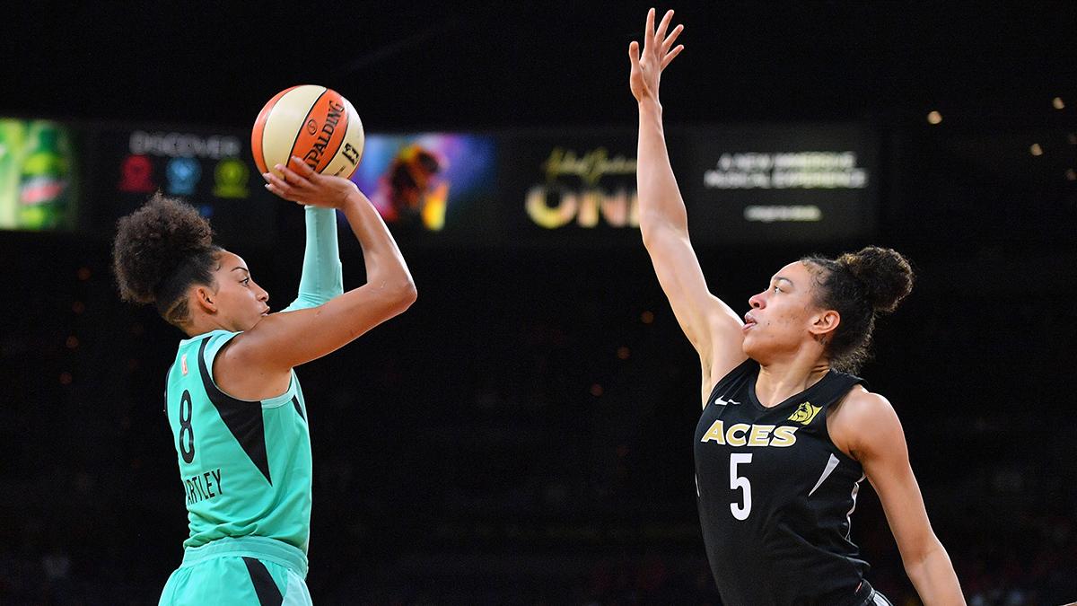 WNBA player Bria Hartley shooting the ball over a defender