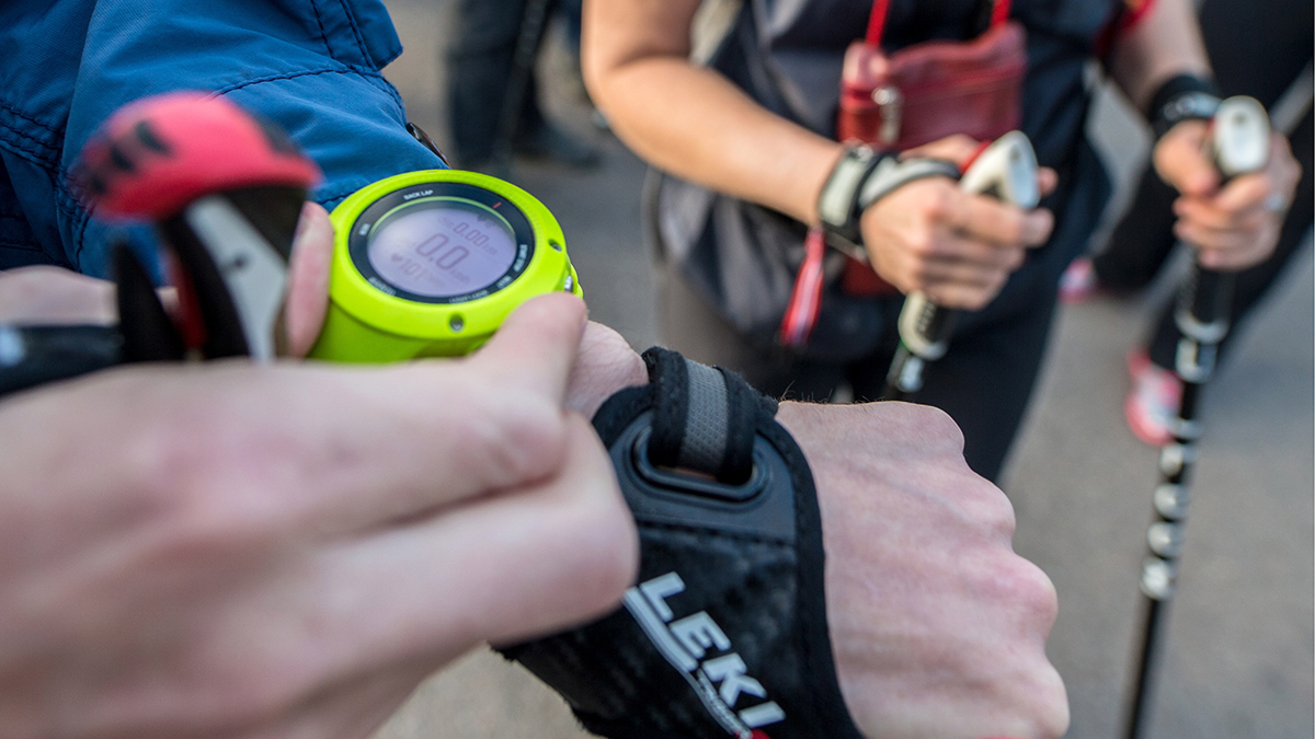 Yellow fitness watch being adjusted.